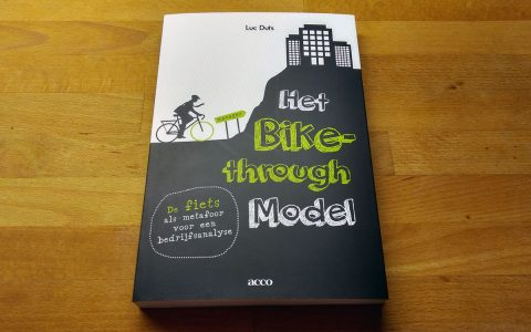 Coverontwerp 'Het Bike-through Model' voor Acco